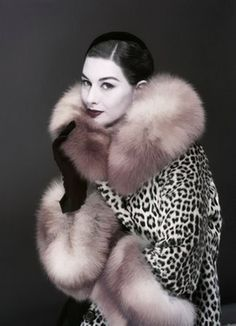Love this coat.  Too bad I don't wear fur.  Not that I could afford it anyway.  November Vogue, 1954