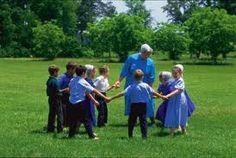 Amish children with teacher