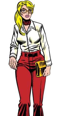 Carol Danvers during the 1970s, with a white blouse and very 1970s trousers. From http://www.writeups.org/ms-marvel-comics-carol-danvers-3/