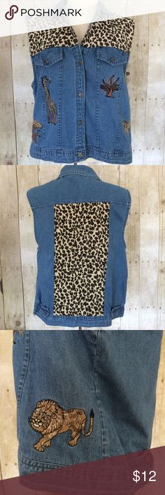 """Cute Animal Print Denim Vest Adorable animal print denim vest in excellent used condition. 6 button front. 22 1/2"""" long center back. 21"""" across at bust line. 100% cotton exclusive of decoration. Please ask questions and check out bundling to save. Dress Barn Jackets & Coats Vests"""