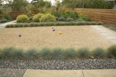 If artificial turf isnt your style, but you want a surface you dont need to water, look for a ground material that will provide minimal bounce. Decomposed granite, sand or crushed oyster shells are all options that do not require water. These are especially appropriate for arid climates and for re-creating an authentic Italian villa feel.