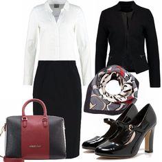 Un outfit classico per donne in carriera. Camicia bianca con completo longuette e giacca nere. abbinate con accessori con note di colore più marcate. Bon ton le décolleté con cinturino in vernice.