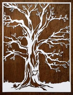 Cut paper tree with wood grain background