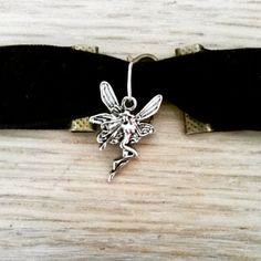 Velvet Choker Necklace with Fairy Pendant  https://www.etsy.com/listing/228612701/velvet-choker-necklace-with-a-tibetan