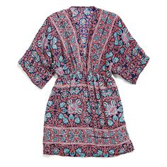 like the pattern - not sure how this would look on me, might work better as a beach coverup than a top over jeans?