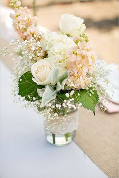 Lace warped glass jar and pale warm tone flowers