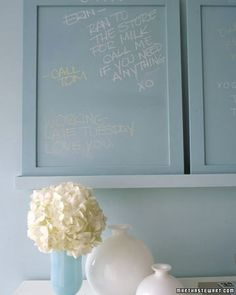 We coated three framed panels with write-on paint and leaned them on an entryway shelf, where they function as miniature chalkboards. To create a similar effect, measure and cut pieces of sanded plywood, and slip them into picture frames. Cover each panel, frame and all, with primer and chalkboard paint; our topcoat coordinates with the aqua-blue walls.