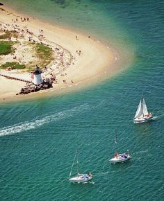 Sailors make their way around Brant Point and into the entrance of Nantucket Harbor