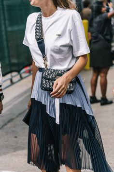 10 ways to style a white tee: White Tee + Pleated Skirt + Logo Bag. More ways to style a white tee on the blog now!