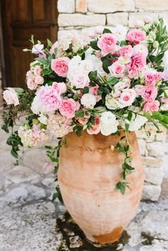 Garden roses, hydrangea, dahlias and spray roses designed in the Urn in front of Ian's Chapel | Whim Florals Photo by Sarah Goss Photography