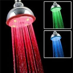 Temperature controlled light changing LED shower head
