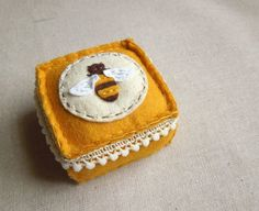 Embroidered Honey Bee Felt Pincushion. $25.00, via Etsy.
