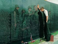 The Vietnam War Memorial by Maya Lin, it does not have a striking height, so that people can touch all the names engraved on the stone, to have a sense of connection to the people passed away, sharing the common feeling of lost with everyone who touch this stone 'scar' into the ground.