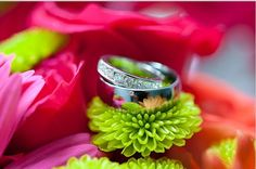 We <3 this wedding ring shot on these gorgeous bright flowers  \\  Kim Chapman Photography