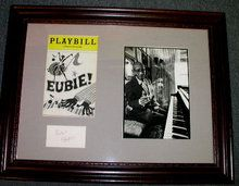 """Eubie Blake Autograph framed with an original """"EUBIE"""" Playbill from the ambassador Theatre and 7""""X7.5"""" Photograph. James Hubert Blake (1883–1983) produced early African-American Broadway musicals, e.g., Shuffle Along (1921). His most famous songs are """"Memories of You"""" and """"I'm Just Wild about Harry."""" Frame measures 23""""X18"""" $595"""