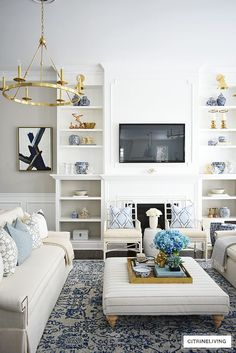 Beautiful and bright spring living room decorating in blue, white and brass plus our new gorgeous brass chandeiers and wall sconces! Fall Living Room, Living Room Pillows, Home Living, Coastal Living, Decor Room, Living Room Decor, Living Rooms, Family Rooms, E Design
