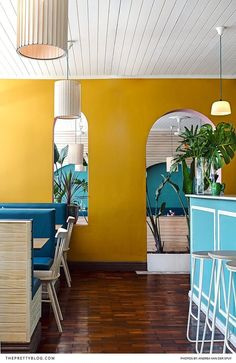 A beautiful and bright tropical inspired Mexican restaurant with yellow walls and blue touches! https://www.theprettyblog.com/food/el-burro-newlands-modern-mexican/