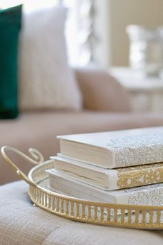 Give worn out old books a fresh new look with a coat of paint (and you can even add a metallic doily like I did to mine this past Christmas).