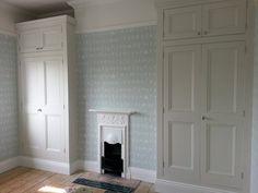 Bespoke alcove wardrobes in Ware, Hertfordshire. Doors traditional handmade Poplar, hung on butt hinges.