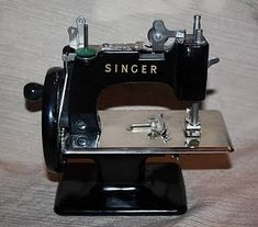 Child size vintage singer sewing machine. So cute!