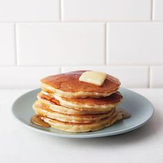 Martha's secret to fluffier pancakes:  1. Bring your wet ingredients to room temperature before using them 2. Make sure not to overwork the batter when whisking wet and dry together 3. Create more loft by folding a few whipped egg whites into the batter.