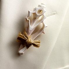 ALL ABOUT HONEYMOONS specializes in Honeymoon & Destination Wedding planning. For more info go to: www.cori.allabouthoneymoons.com. Become our FAN on Facebook: https://www.facebook.com/AAHsf    Men's White coral boutonniere