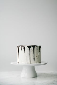 layered vanilla cake with buttercream frosting and chocOlate ganache