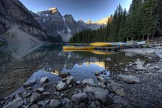 Moraine Lake Canoes - Jeremy Duguid    My last shot of Moraine Lake was the standard shot from atop the rock pile. This one is from the edge of the lake. While we didn't have any clouds in the sky on the morning we visited Moraine Lake, it was still a beautiful morning and we were able to get some great reflections off the lake. I loved Banff and there were so many wonderful places to see, but Moraine probably tops the list.