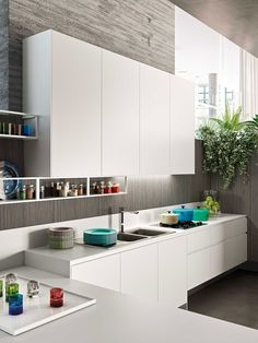 White wall mounted cabinets make use of vertical space in the kitchen Posh Kitchen Compositions Fuse Modularity with Minimal Aesthetics