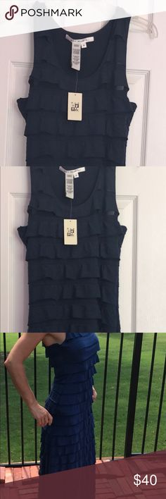 NWT Max Studio MAXI Navy Dress Medium Ruffle Nee NWT Max Studio MAXI Navy Dress Medium Ruffle. Super cute! This dress has been hanging in my closet and it's time to pass it on! Super slimming and stylish Max Studio Dresses Maxi