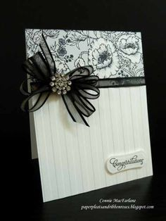 Stamps - Picking Wildflowers, Tag Lines (Flourishes) Ink - Memento Tuxedo Black, Copics - C1, C3, C5, C7 Paper - Neena Classic Crest Solar White CS Accessories - black ribbon (Offray), Rhinestone brad (CTMH) Other - Classic Hourglass die (Flourishes), Stripes EF (SU),