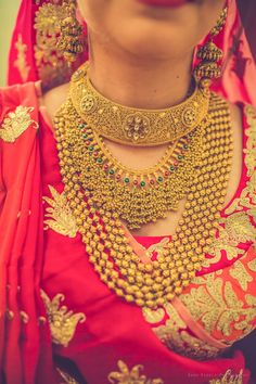 Indian Wedding Jewelry - Bride Wearing Gold Jewelry| WedMeGood | Bride in a Red Lehenga with a Gold Choker Necklace and two layered Gold Necklaces #wedmegood #indianwedding #indianbride #gold #jewelry #weddingjewelry #layered