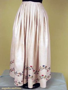 "Augusta Auctions - 18th century - Crewel Embroidered Petticoat - White cotton woven stripe ground, double meandering row of multi-colored flowers near hem, W 24"", L 32.5"", (1 repair, waistband replaced) good."