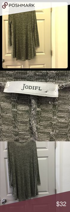 "Jodfil dress Large in Rayon, Polyester & Spandex Beautiful waited fabric in white and olive green checkered pattern. With long sleeves, scoop neck and tent hem.  Dress is 36"" Long it center and 22 across from armpit to armpit in front.  Made in USA hand wash in cold water. Jodifl Dresses Midi"