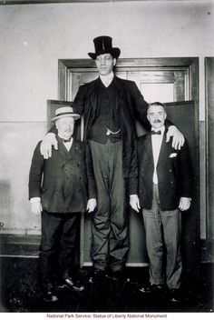 Russian giant at Ellis Island (Photograph by Augustus Sherman)
