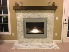 Brighten up your fireplace with the modern, contemporary aesthetics of this mosaic tile  -  Tempesta Neve Polished Amalfi Marble Mosaic Tile - 12 x 12 in.