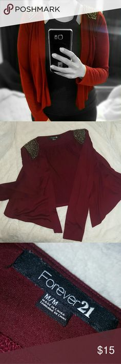 FOREVER 21 Crop Sweater This is a cute sweater for a formal casual outfit. It's a medium but I feel it runs a little too small to be a medium. Only worn twice. I'm modeling it on the covershot but the color is actually a deep burgundy. Thinn, light feel to it. No wears or damages. Forever 21 Sweaters Cardigans