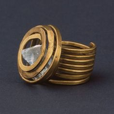 Ring | Alexander Calder. ca 1930s - 1940s. Brass and glass (crystal) (for a daily dose of jewelry go to Go to http://www.jewelrygig.com). Collection of MOMA the Museum of Modern Art, New York. Made possible by the James Thrall Soby Bequest.