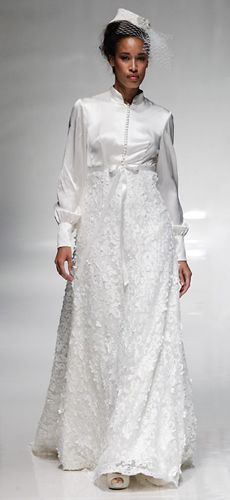 A wonderfully elegant coat-style wedding gown by Alan Hannah