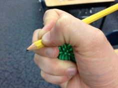 Tip for helping kids manage their pencil grip.  Have them hold a ball or cotton ball in their ring and pinky fingers.  This forces these fingers to stay busy, while the pincer fingers hold the pencil!