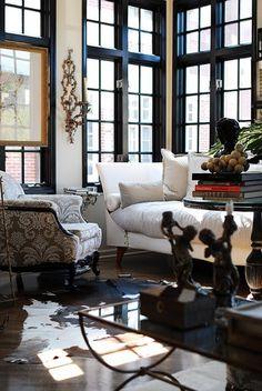 It's all in the details.  Dark pane windows provide light and a stunning backdrop to a lovely living space.