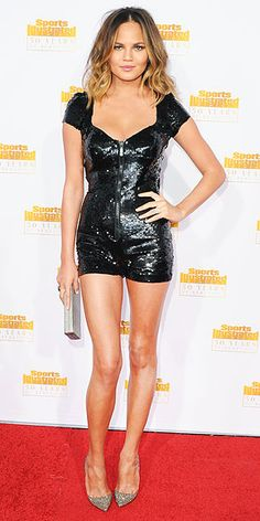 Chrissy Teigen in black sequin romper at Sports Illustrated 50 Years of Beautiful party in Hollywood