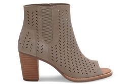 Scale metropolitan heights in this airy and adventurous bootie, inspired by the Spanish Mediterranean. In perforated suede with a peep-toe, it stands bold on a stacked leather heel.