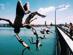 Cats in their late teens jumping' off a bridge to beat the heat. Summer's winding down - get your licks in!