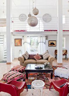 Eclectic modern Moroccan living room that is light and airy from natural lighting and bold pops of color. Moroccan Interiors, Amber Interiors, Moroccan Decor, Modern Moroccan, Moroccan Lanterns, Moroccan Style, Home Living Room, Living Area, Living Spaces