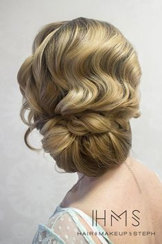 love the finger wave effect of this romantic wedding updo! ~  we ❤ this! moncheribridals.com