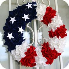 Felt Patriotic Wreath Tutorial ~ It's made using a foam wreath form and small squares of felt, pressed in to the foam with a skewer stick. We did have the idea to include some springy stars and they are a cute touch.