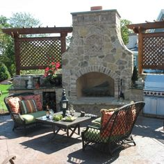 beautiful backyard fireplace with arbor sides to screen out neighboring view ~ from Hooked On Houses Blog from Home-a-Rama img_9206
