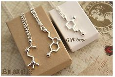 Reduced by $1.50  Chemistry of Love! This necklace is made of a charm in the shape of acetylcholine molecule. It measures about 18 (46cm). The chain is silver tone and zinc alloy. You can choose to add an initial. The initial measure between 3mm - 10mm x 16mm.  This pendant is packaged in a gift box (white color for Canadians).  Precautions: Do not wear in water or with cream or lotion to prevent oxidation of the metal. This pendant can tarnish depending on the ph of your skin.  This…