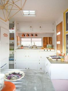 Over on the Vintage Revivals blog, DIY whiz Mandi Gubler has a big reveal: the tiny, drab 1972 Bell Travel Trailer she bought for $1,000 in July has been transformed into a relatively more spacious...